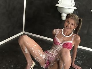 Perverted Svelte Swimsuit Doll Poses Right On The Floor And Gets Covered With Faux Jizz