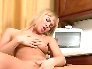 Gena Masturbates In The Kitchen