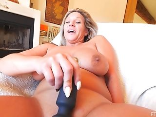 Large Natural Tits Matures Meegan Wails While Masturbating On The Sofa