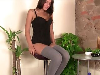 Doting Dark Haired Takes Off Her Sexy Stockings Exposing Her Pedicured Toes