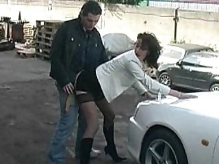 Clothed Female Gets Fucked On A Car Fetish Mask